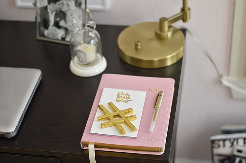 Pink, Desk, Office, Home decor, desk decor, cute desk, flowers, desk lamp, gold spike decor, candles, diptyque, pink books, cute desk, bookends, jonathan adler, roses, lip print, desk diary, desk calendar, girly desk, at home desk