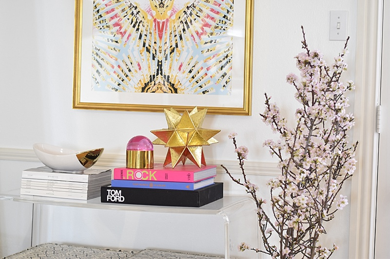 Leopard Pillows, Coffee Table Books, Coffee Table, Mirrored Coffee Table, Peonies, Gold Vase, Candles, LAFCO Candle, Side Table, Lulu & Georgia, Diptyque Candle, pink flowers, side table decor, Jonathan Adler, acrylic side table, gold object, cherry blossom branches