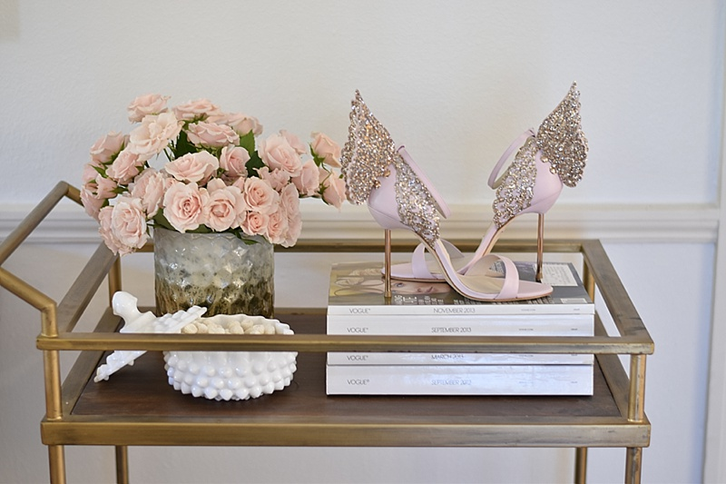 Living Room Decor, Shoes as decor, magazines, spray roses, pink roses, Pink heels, Sophia Webster Heels, Angel Wing Heels
