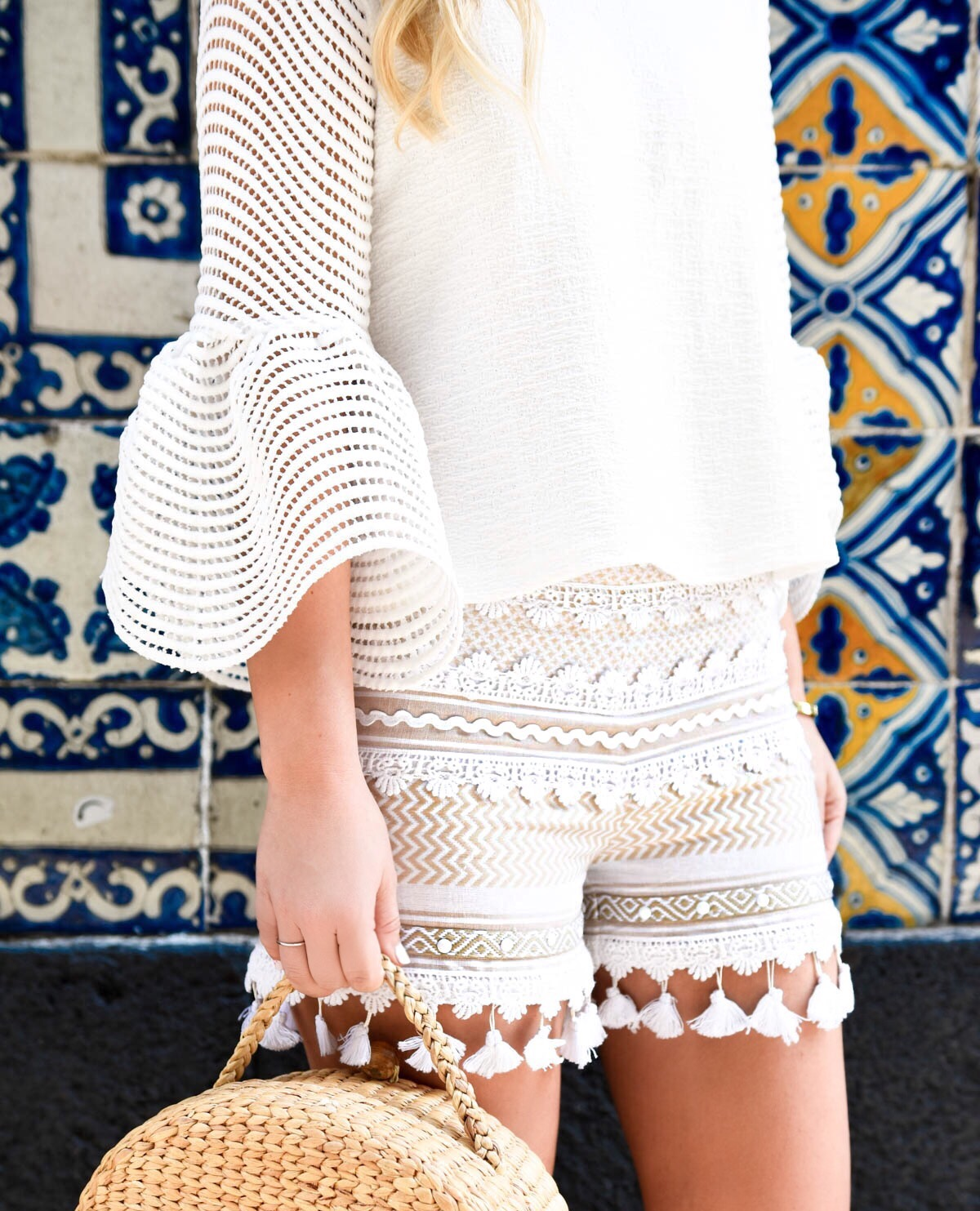 Bell-sleeve-top, White-tassel-shorts, Beach-bag, Ray-Ban-sunglasses